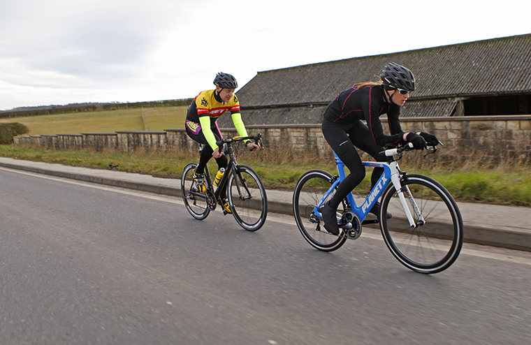 Planet X founder Dave Loughran drafting pro triathlon rider Eimear Mullen on the Cuckney 10